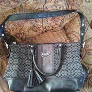 Black and silver Coach purse